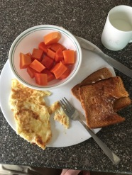 My First Breakfast - Egg & Cheese Omelette, Buttered Toast (bless up), and Juicy Papaya